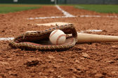 Baseball & Bat near Home Plate — Stock Photo