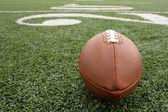 Football with the Twenty Yard Line Beyond — Stock Photo