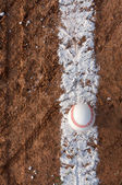 New Baseball on the Chalk Line — Stockfoto