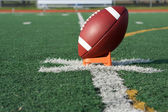 American Football teed up for kickoff — Стоковое фото