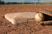 Baseball and Glove near Second Base — Stockfoto