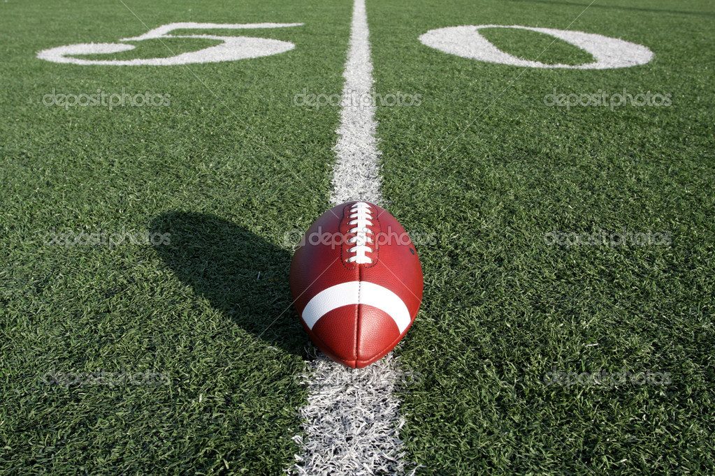 American Football with the Fifty Yard Line Beyond — Stock Photo #6925208
