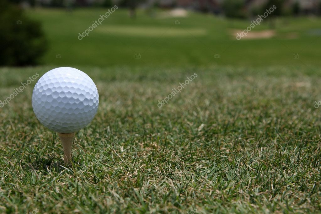 Golf Ball Teed Up with Course Beyond — Photo #6926276