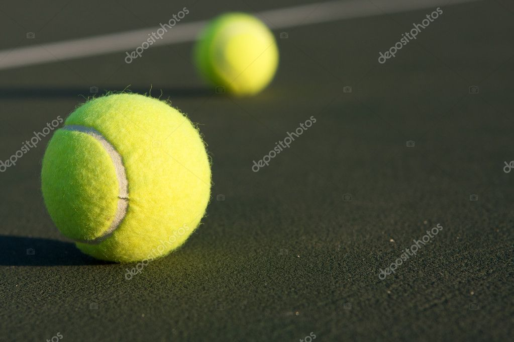 Tennis Ball on the court with ball in the background — Stock Photo #6926339