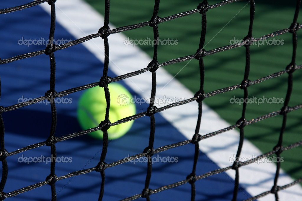 Tennis Court Net close up with the ball and court in background — Stock Photo #6926496