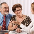 Royalty-Free Stock Photo: Senior couple meeting with financial advisor