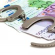 Money and handcuffs — Stock Photo