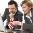 Stock Photo: Two businesspeople working at office