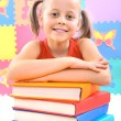Smiling little schoolgirl with the books - Foto Stock