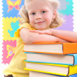 Royalty-Free Stock Photo: Smiling little schoolgirl with the books