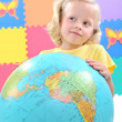 Child holding a globe — Stock Photo