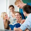Young students studying together — Stockfoto