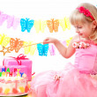 Little princess and her birthday cake — Stock Photo