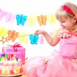 Stock Photo: Little princess and her birthday cake
