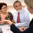 Senior couple meeting with financial advisor — Stock Photo #6842874