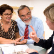 Senior couple meeting with financial advisor — Stock Photo #6842944