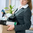 Woman laid off from her white collar job carries a box of her belongings — Stock Photo #6842996
