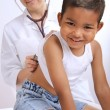 Female doctor examining little child boy — Stock Photo