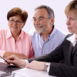 Senior couple meeting with financial advisor — Stock Photo #6843691