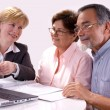 Senior couple meeting with financial advisor - 