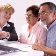 Senior couple meeting with financial advisor - Stock Photo