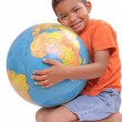 Child holding a globe on the white background — Stock Photo