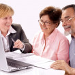 Senior couple meeting with financial advisor — Stockfoto