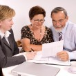 Senior couple meeting with financial advisor — Stock Photo #6844054