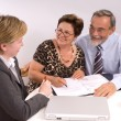 Senior couple meeting with financial advisor — Stock Photo #6844092