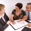 Senior couple meeting with financial advisor — Foto de Stock