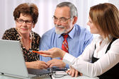 Senior couple meeting with financial advisor — Stock Photo