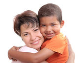 Little African boy in adoptive mothers arms — Stock Photo