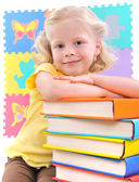 Smiling little schoolgirl with the books — Stock Photo