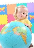 Child holding a globe — Stock Photo