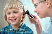 Doctor examining little child boy — Stock Photo