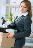 Woman laid off from her white collar job carries a box of her belongings — Stock Photo