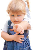 Small girl shows a finger forwards — Stock Photo
