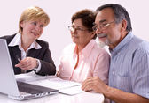 Senior couple meeting with financial advisor — Stock Photo