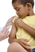 Doctor give injection to boy's arm — Foto Stock