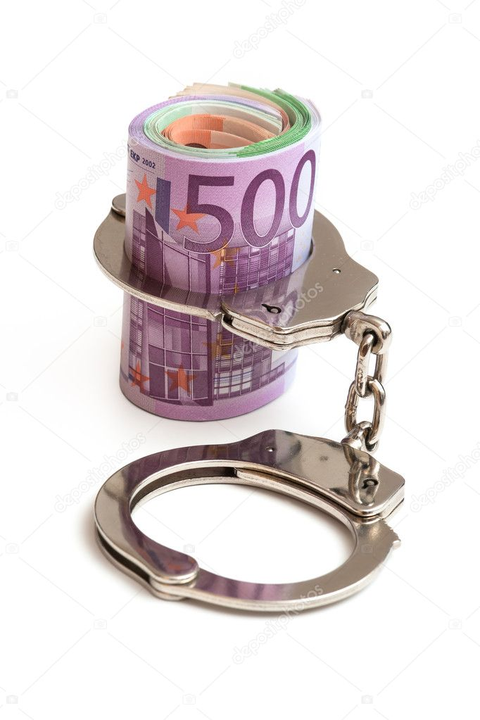 Money and handcuffs  — Stock Photo #6841703