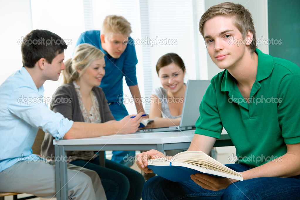 Group of students studying together in a classroom — Stock Photo #6842100