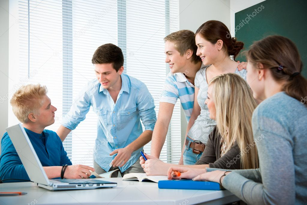 Group of students studying together in a classroom — Stock Photo #6842126