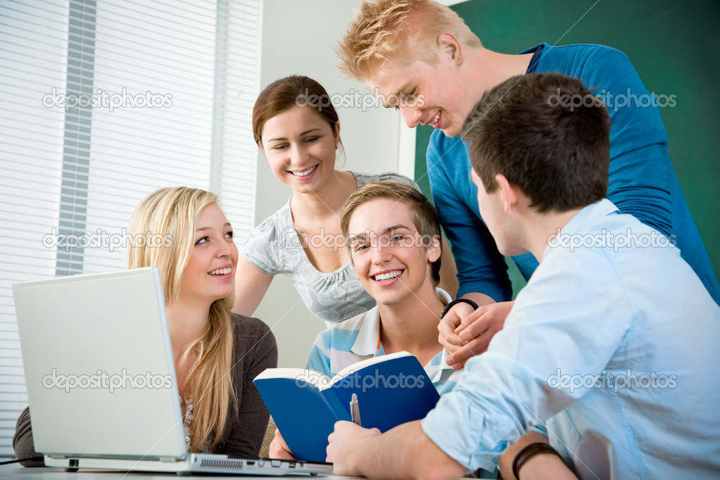 Young students studying together in a classroom  — Stock Photo #6842295