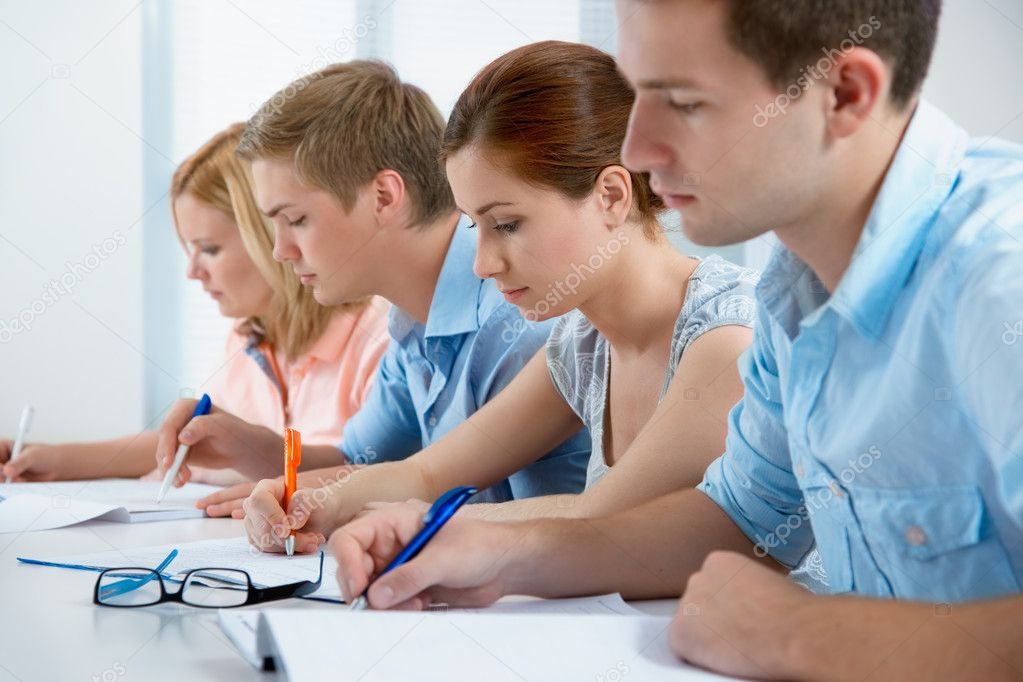 Young students studying together in a classroom  — Stock Photo #6843280
