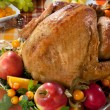 Roasted turkey on holiday decorated table — Stockfoto