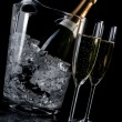Champagne flutes and ice bucket — Stock Photo #6855708