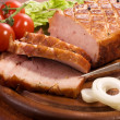 Close-up of a roast tenderloin pork - Stock Photo