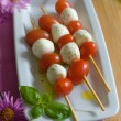 Cherry tomatoes and mozzarella on skewers - Stock Photo