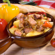 Pork stew with potatoes - Stock Photo