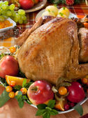 Roasted turkey on holiday decorated table — Stock Photo